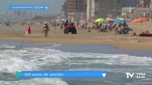 Primera multa por bañarse con bandera roja en una playa de Guardamar del Segura